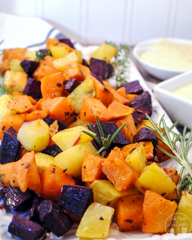 Roasted Sweet Potatoes - Savory roasted sweet potatoes flavored with fresh herbs of chives, rosemary, and thyme and served with a rosemary garlic aioli