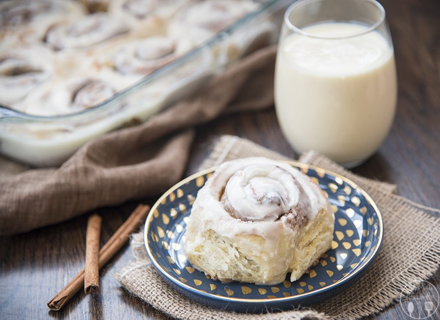 Eggnog Cinnamon Rolls - These eggnog cinnamon rolls are perfectly delicious! A soft gooey roll, filled with nutmeg and cinnamon sugar and topped with an amazing eggnog glaze. Perfect for a holiday breakfast or dessert!