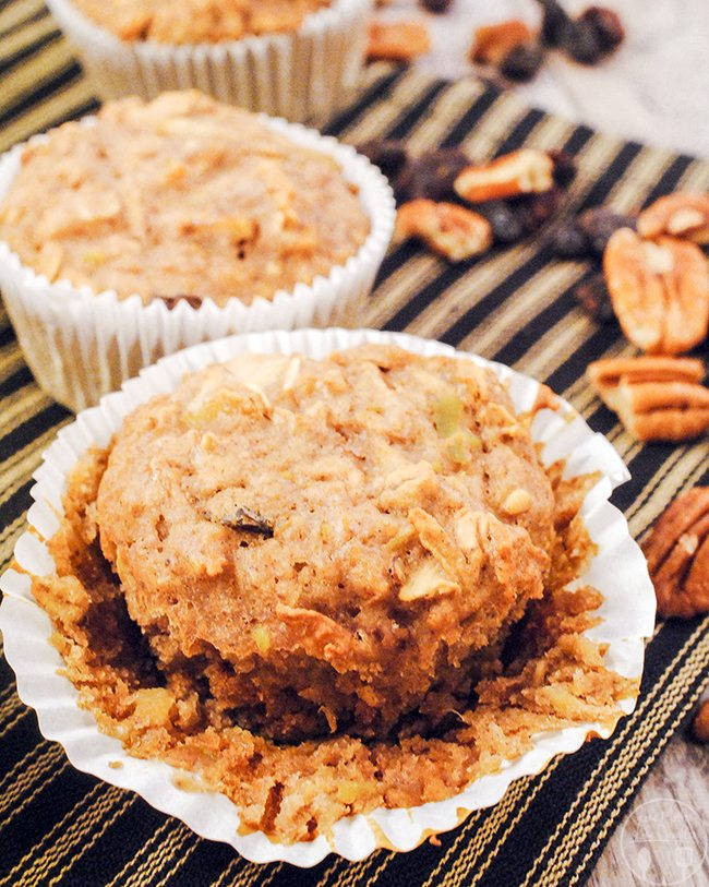 Oatmeal Raisin Muffins - This delicious muffin has the same great taste as an oatmeal raisin cookie, and is packed full of healthy bits; like grated apples, pineapples, pecans, cinnamon, almond milk – and they're even vegan too!
