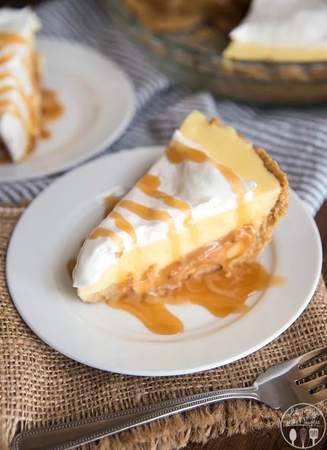 Caramel banana cream pie has a delicious graham cracker crust, followed by a caramel layer, topped by banana pudding and whipped cream for a delicious twist on traditional banana cream pie!!