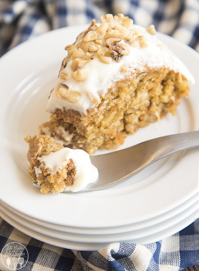 Lighter Carrot Cake - This gluten free carrot cake is made lighter with half the oil, sugar and eggs but just as much flavor! Topped with a homemade cream cheese glaze, this moist carrot is to die for!