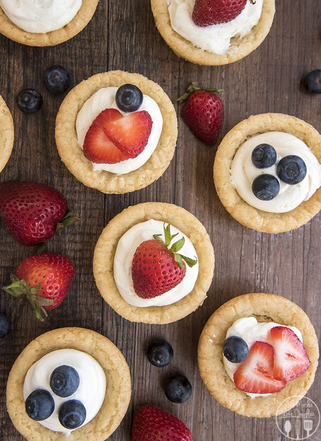 Cheesecake Sugar Cookie Cups - These amazing cookie cups have a sugar cookie for a crust, toppedwith a simple no bake cheesecake filling and your favorite fruit. These cookie cups are perfect for an easy yet elegant dessert.