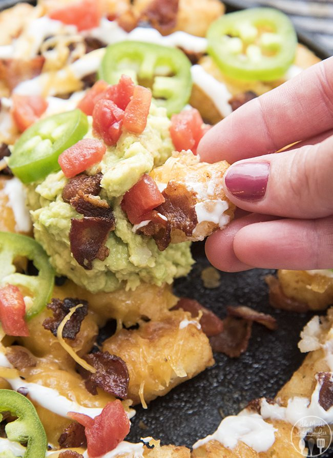 Party Tots - Delicious crispy baked tator tots topped with cheese, sour cream, bacon, jalapeno, guacamole and tomatoes for an amazing appetizer that everyone will love!