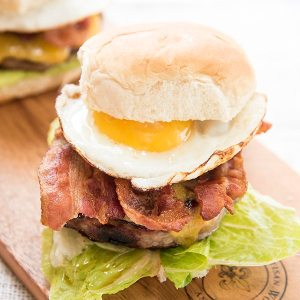 This bacon and egg cheeseburger is a perfect burger with a breakfast twist. It starts with a premium pork patty, topped with cheese, crispy bacon and a fried egg!