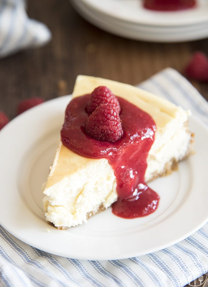 Pretzel Crusted Cheesecake with Raspberry Sauce - This cheesecake is a rich and creamy cheesecake topped with the best raspberry sauce. Its a classic cheesecake with a twist, and it is to die for!