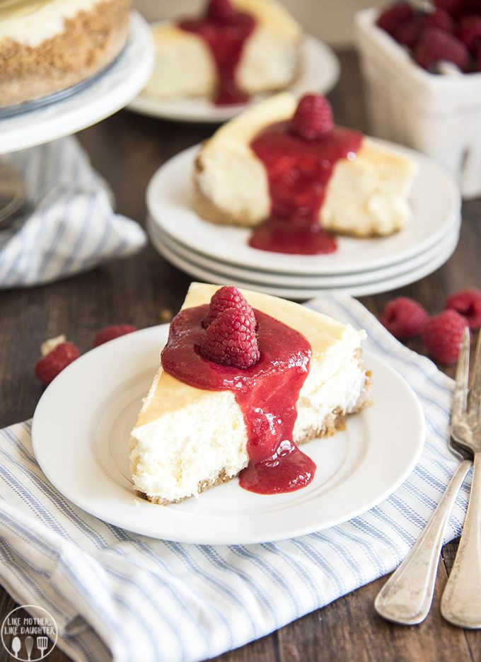 Pretzel Crusted Cheesecake with Raspberry Sauce - This cheesecake is a rich and creamy cheesecake topped with the best raspberry sauce. Its a classic cheesecake with a twist,and it is to die for!