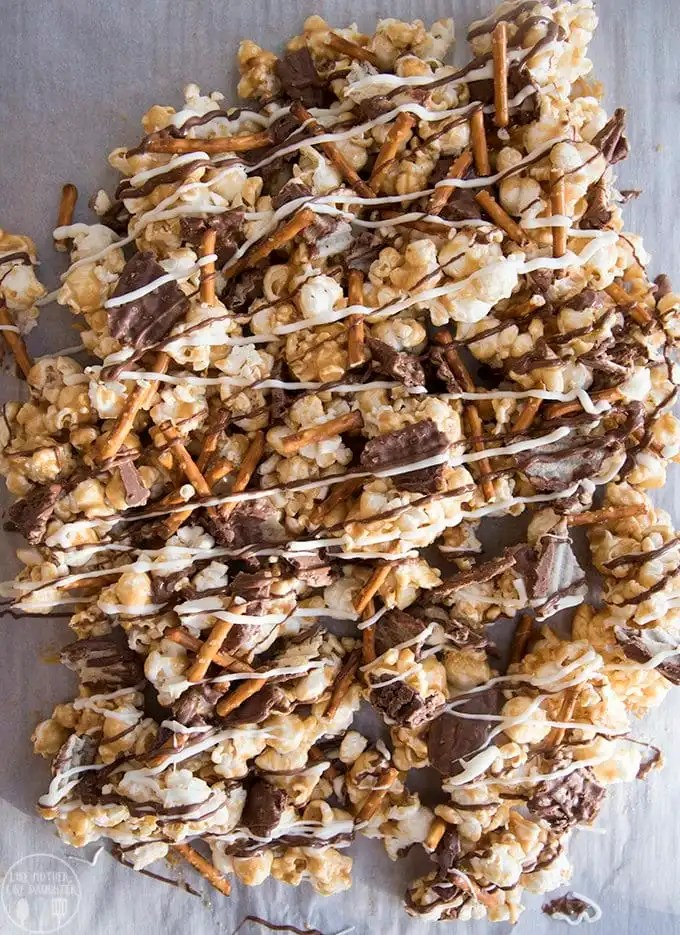 This potato chip and pretzel caramel popcorn is the perfect sweet and salty treat! Gooey caramel popcorn full of salty pretzels, salty and sweet chocolate dipped potato chips and drizzled in more milk and white chocolate!