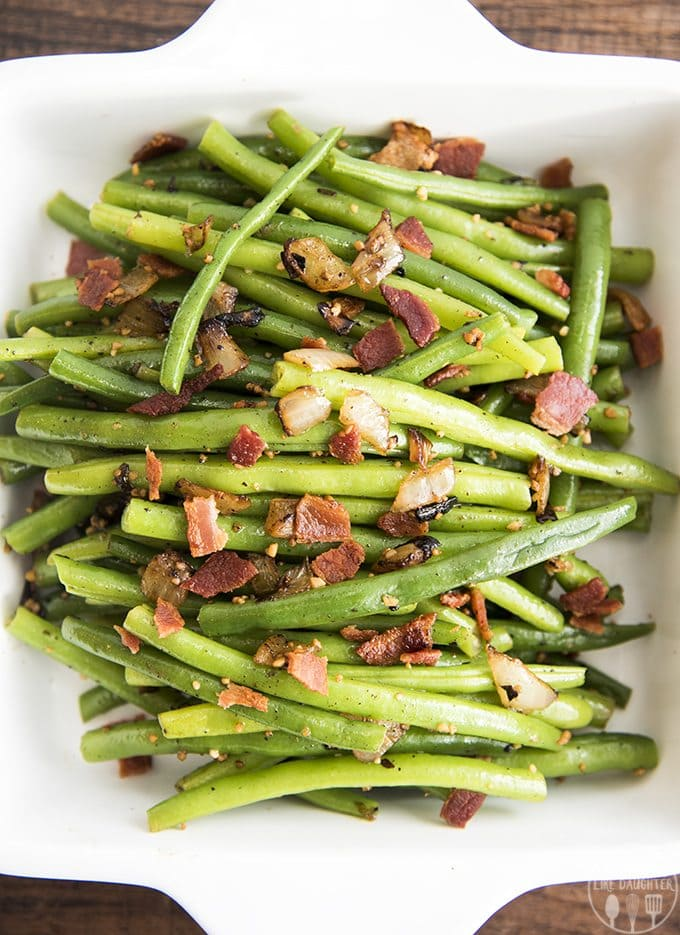 These green beans with bacon are delicious fresh cooked green beans mixed with crispy bacon, sauteed onion, garlic and salt and pepper for a delicious side dish to add to any meal!