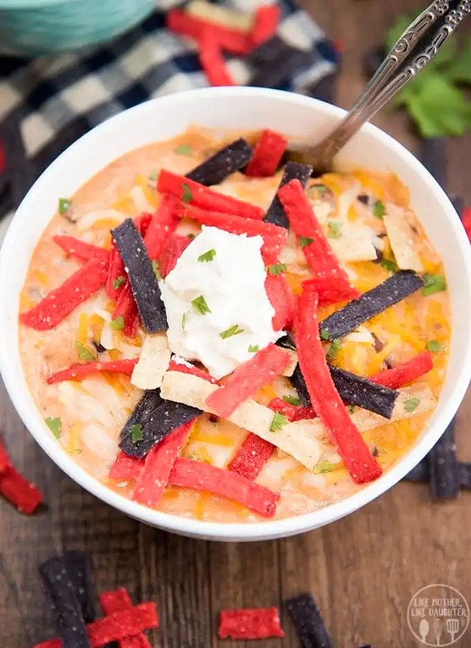 Creamy chicken enchilada soup is packed full of flavors with black beans, shredded chicken, corn, diced tomatoes and more for a creamy and delicious, comforting bowl of soup that everyone will love!