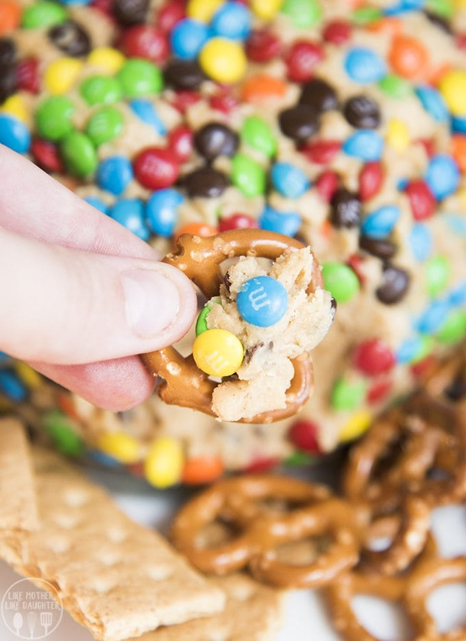 Peanut butter cheeseball stuffed full of chocolate chips and loaded with m&ms for a dessert that tastes like monster cookie dough!