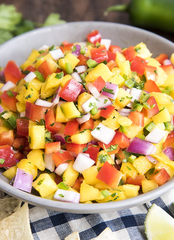 Fresh mango salsa is easy to make, with mango, bell peppers, red onion and packed full of flavor. its so delicious served with chips, on grilled meat, tacos, and more!
