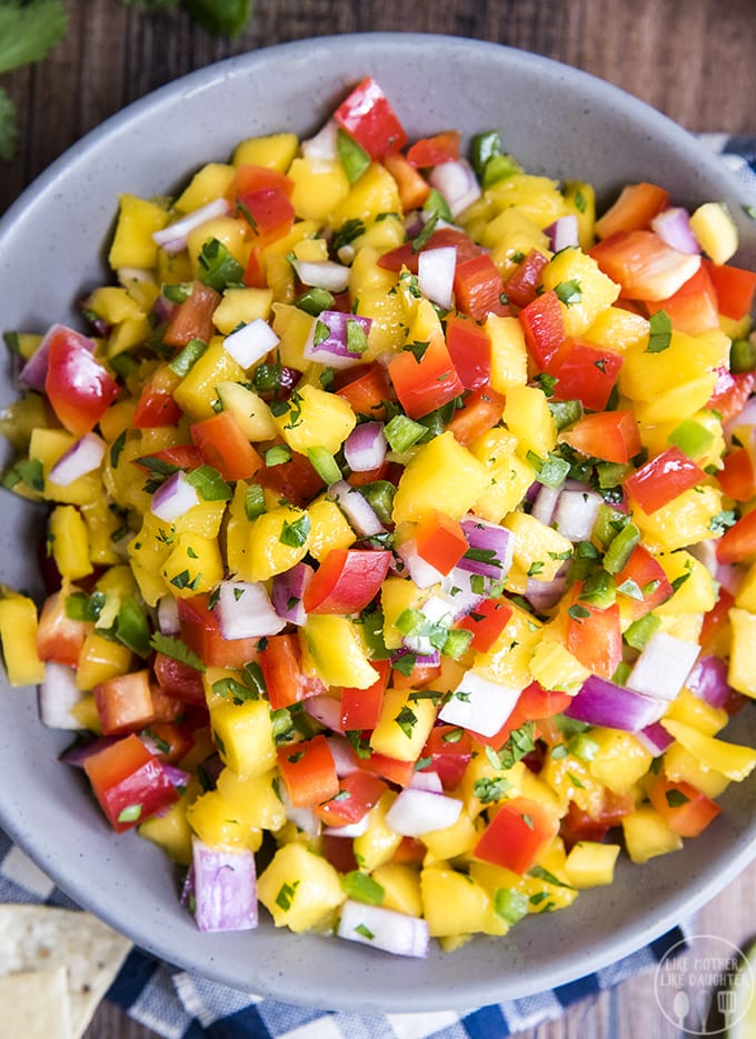 This fresh mango salsa recipe is easy to make, and its so delicious served with chips, on grilled meat, tacos, and more!