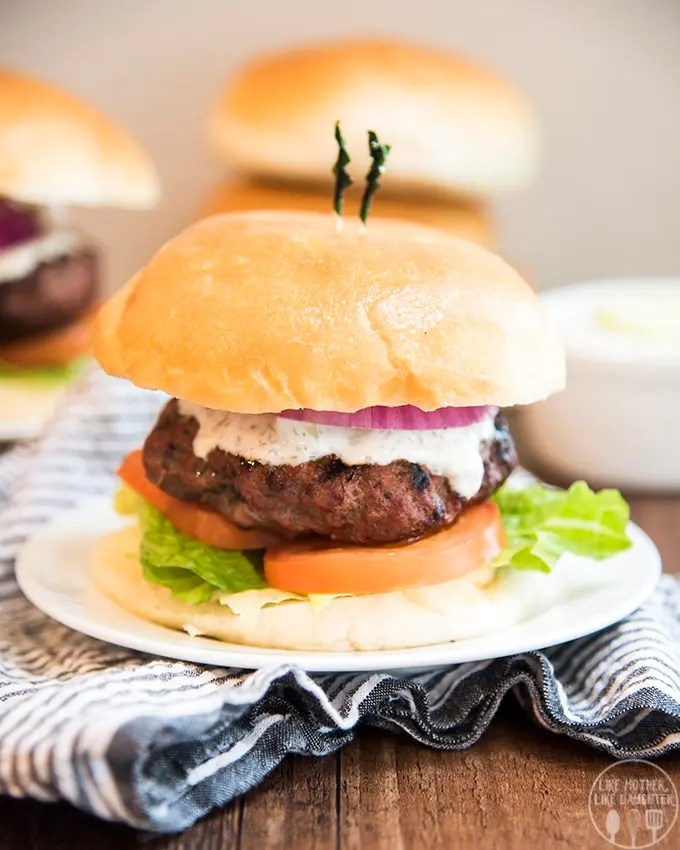 Greek gyro lamb burgers have the same great flavors of a gyro in burger form. With a perfectly seasoned grilled lamb burger topped with homemade tzatziki sauce.