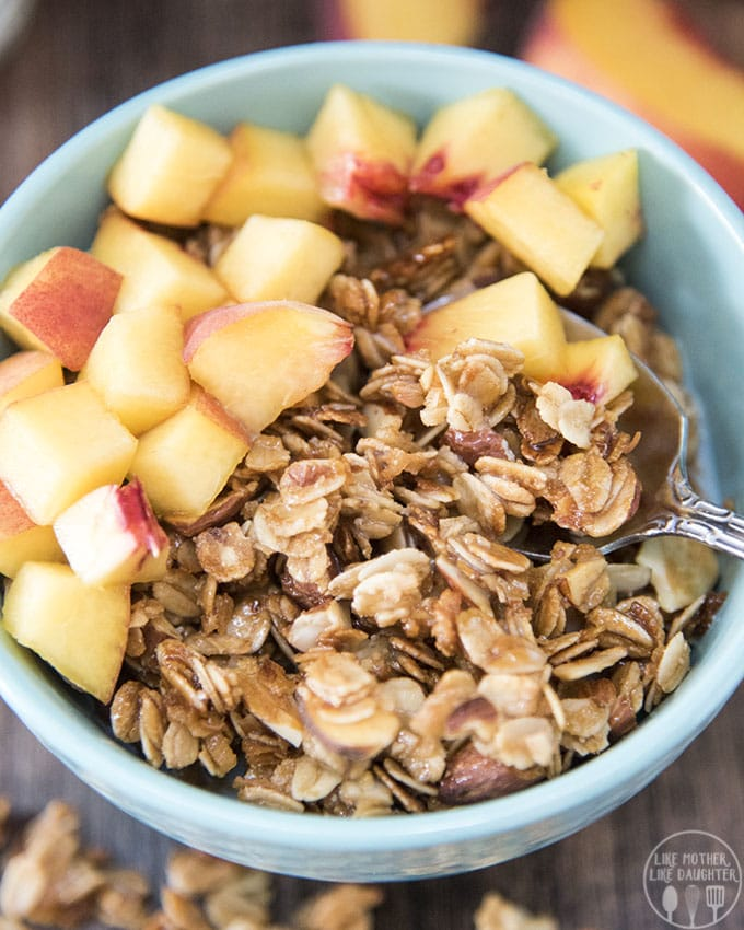 This easy granola recipe is packed full of oats, shredded coconut, and chopped almonds, with a honey sauce, it's a delicious sweet, crunchy granola, bursting full of flavor. Its perfect with milk, fruit, or yogurt, or delicious plain for a quick breakfast or snack!