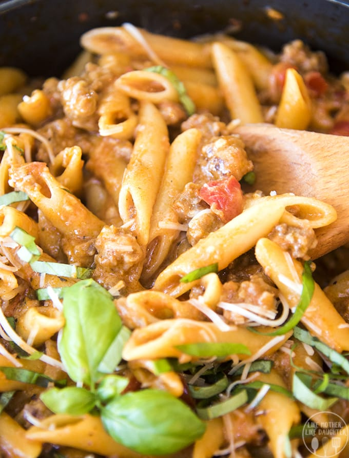 One pot sausage pasta is a delicious and hearty pasta dish packed full of flavor with a creamy marinara sauce, penne noodles and sausage, perfect topped with fresh basil and parmesan cheese!