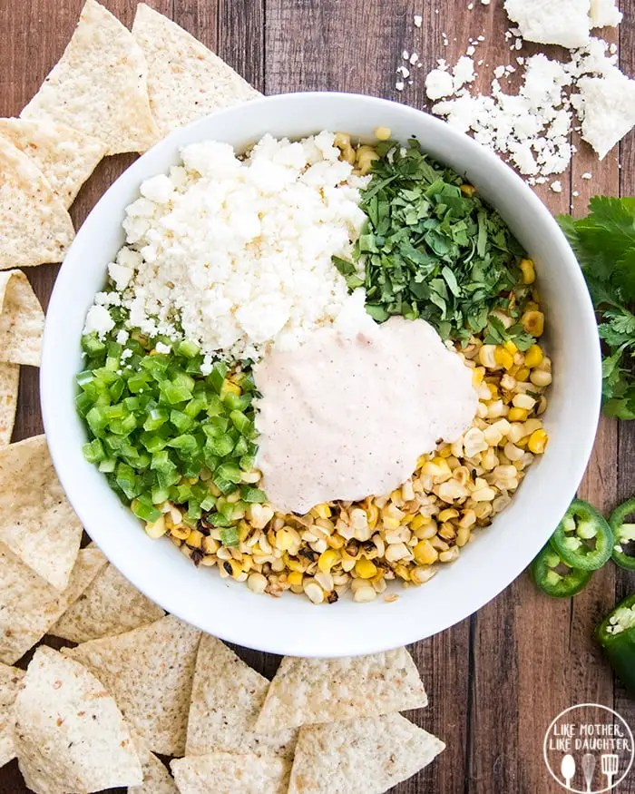 Mexican Street Corn dip with cotija cheese, cilantro, diced jalapeno and a creamy sauce.