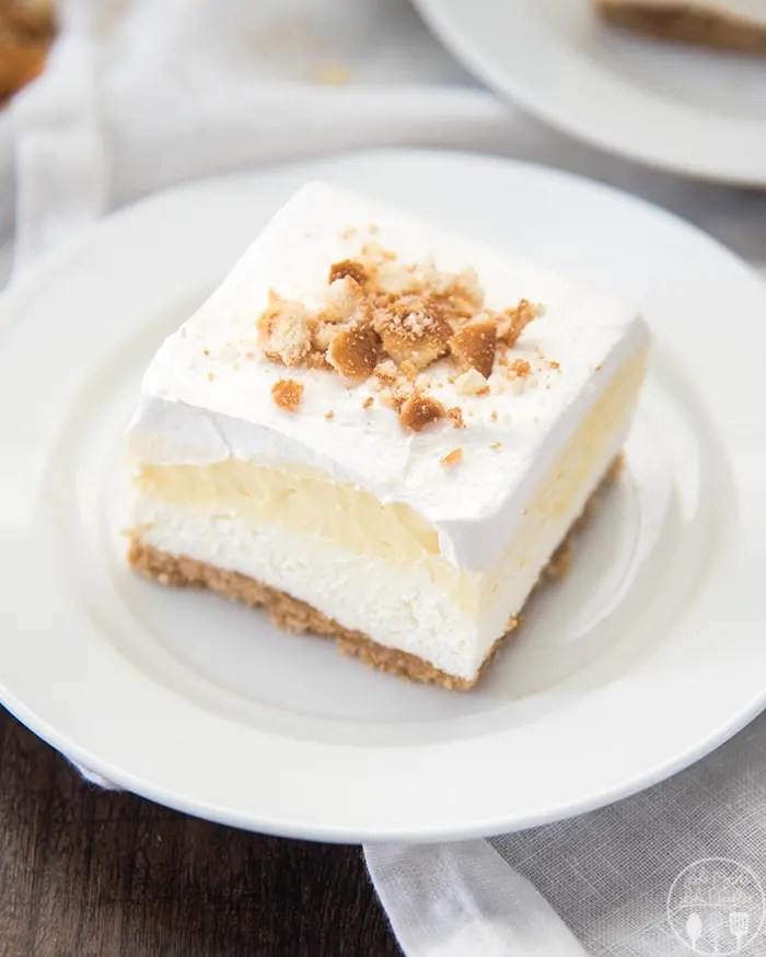 Banana Cream Pie Bars are a delicious no bake dessert! They start with a cookie crust, a homemade cheesecake filling, and banana pudding, all topped with a creamy whipped topping!