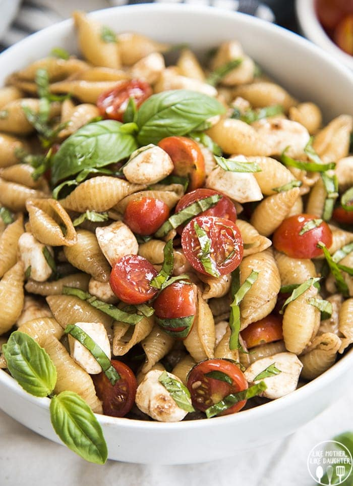 Caprese pasta salad is a delicious pasta salad with the ingredients of caprese salad; fresh mozzarella, basil, and tomatoes, mixed with noodles and tossed with a balsamic vinegar dressing and its a delicious refreshing side dish, perfect to eat all summer long!