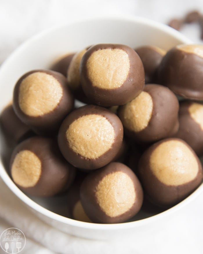 Buckeye Balls are the classic delicious Homemade Peanut Butter Balls dipped in chocolate to resemble the Buckeye Nut, for the perfect easy, no bake dessert.