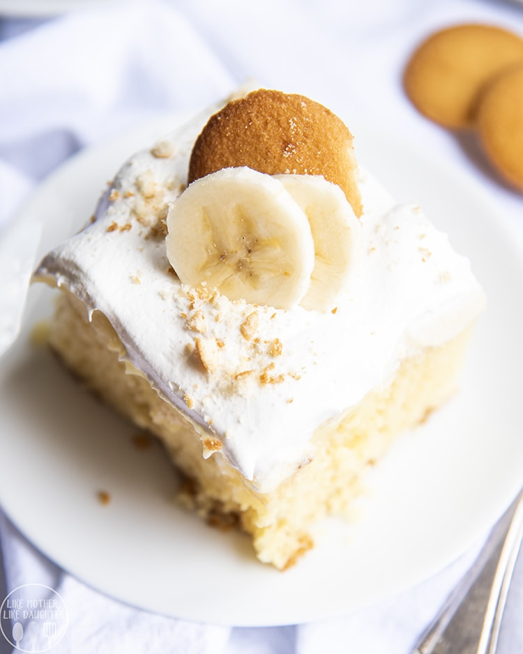 A slice of banana pudding poke cake
