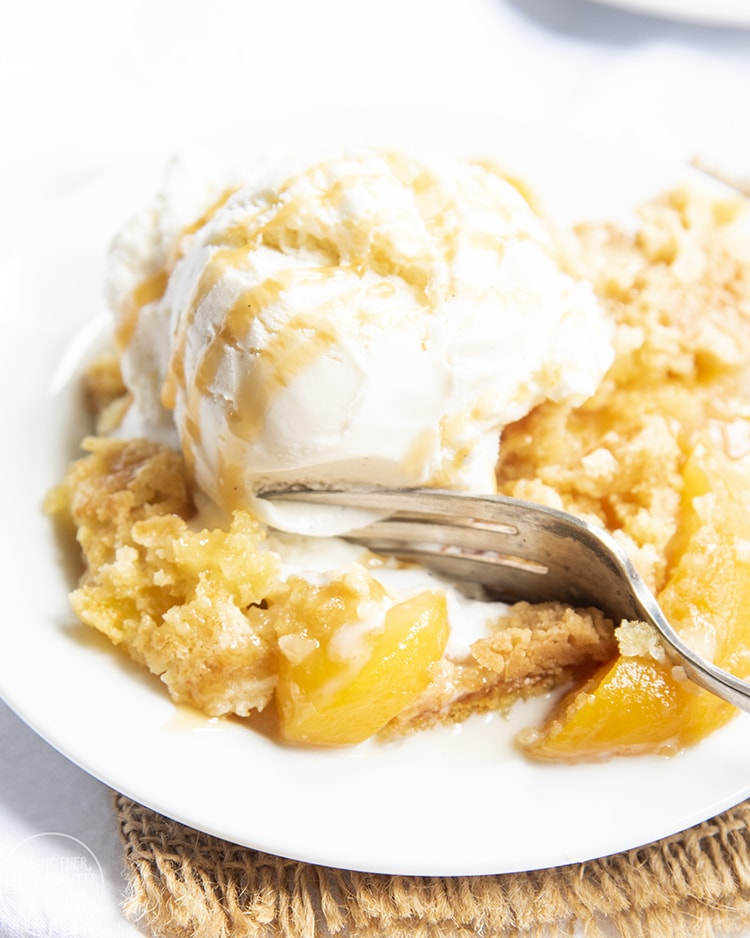 Peach Dump Cake topped with ice cream