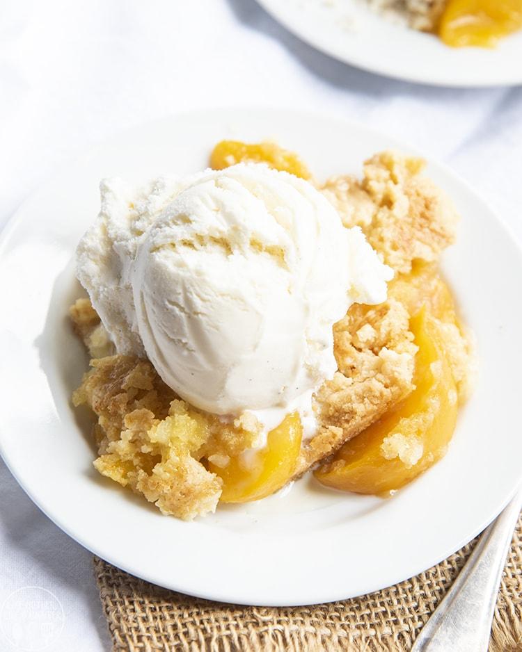 Peach cobbler topped with vanilla ice cream
