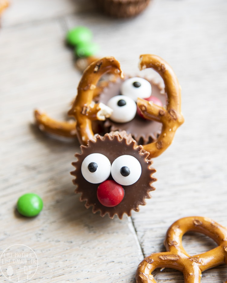 Reindeer Peanut Butter Cups with pretzel antlers