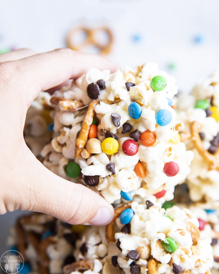 Sweet and Salty Popcorn balls full of pretzels, peanuts, m&ms and chocolate chips