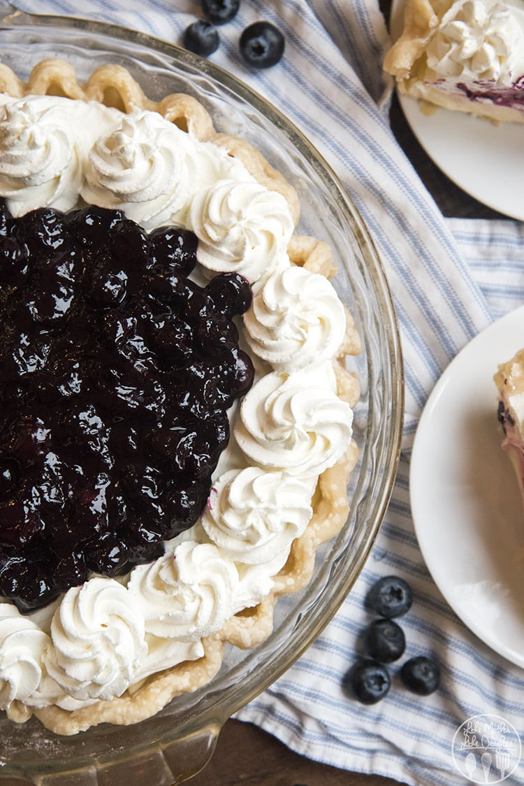 Lemon Sour Cream pie topped with blueberry sauce