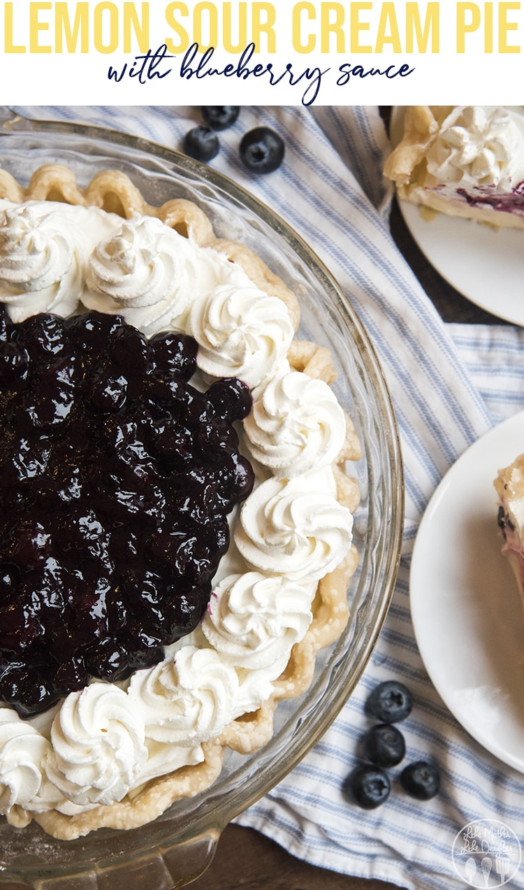 This lemon sour cream pie with blueberry sauce is a crowd pleaser. It's a tangy and sweet lemon sour cream custard topped with homemade whipped cream and a sweet blueberry sauce!