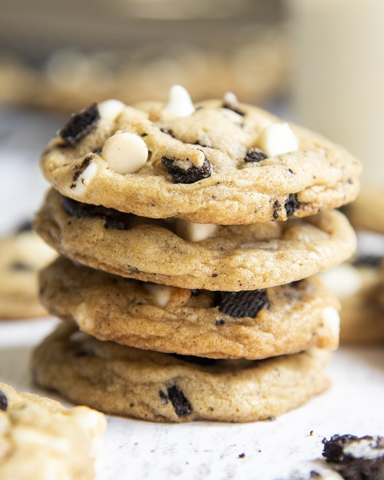 A stack of cookies and cream chocolate chip cookies