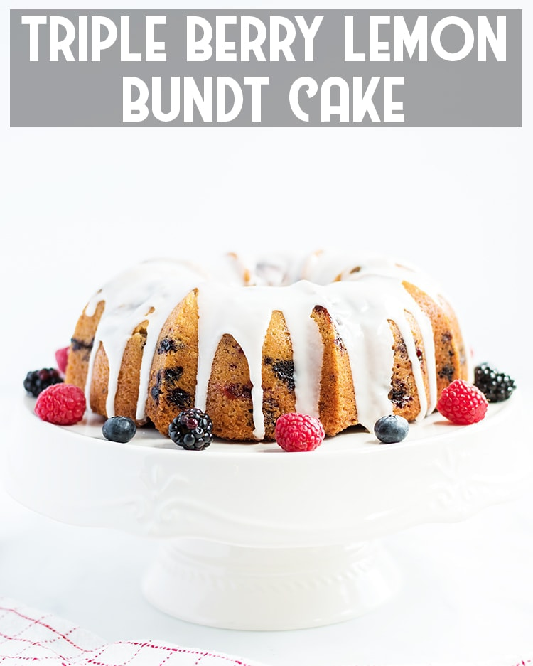 Berry Lemon Bundt Cake on a white cake stand with text overlay for pinterest