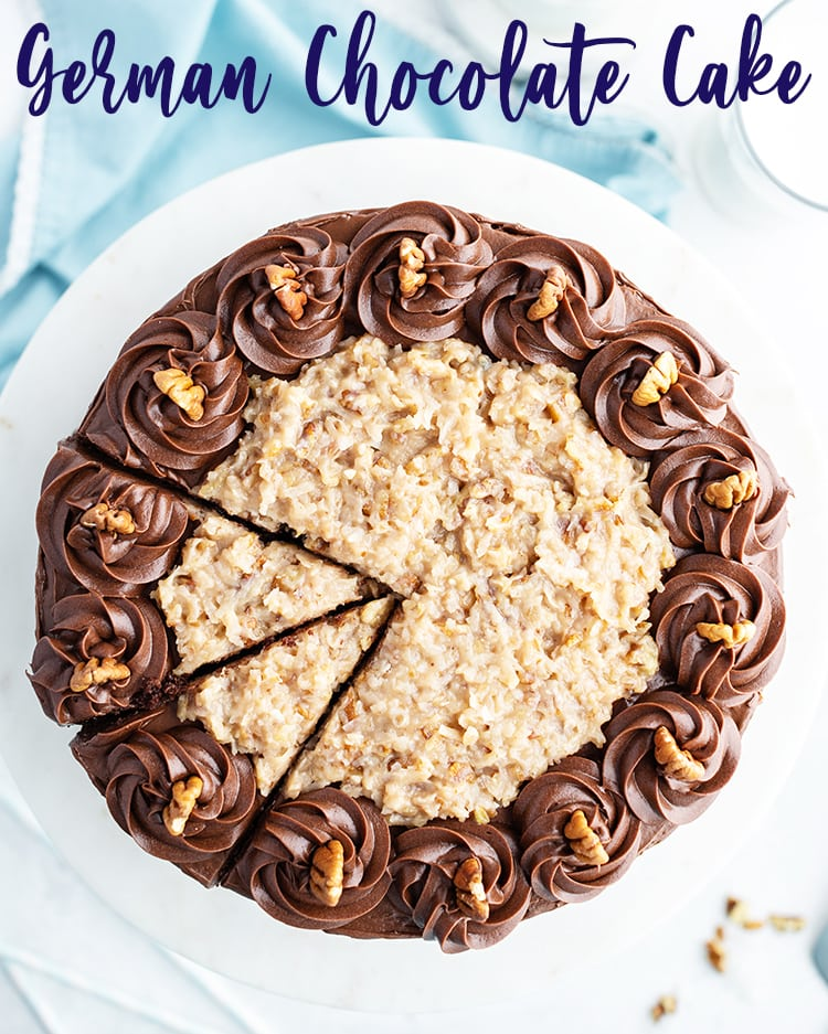 A German Chocolate Cake from above with coconut pecan frosting, and chocolate buttercream rosettes on the edges.