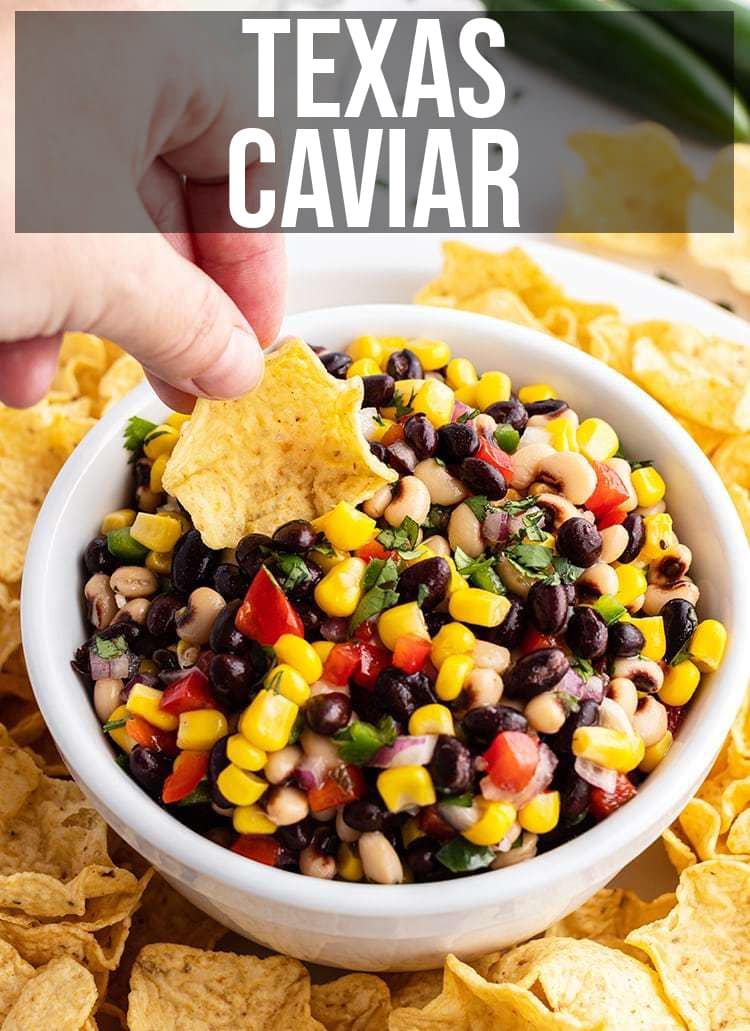 A bowl of chip dip made with black beans, corn, red pepper, and more.