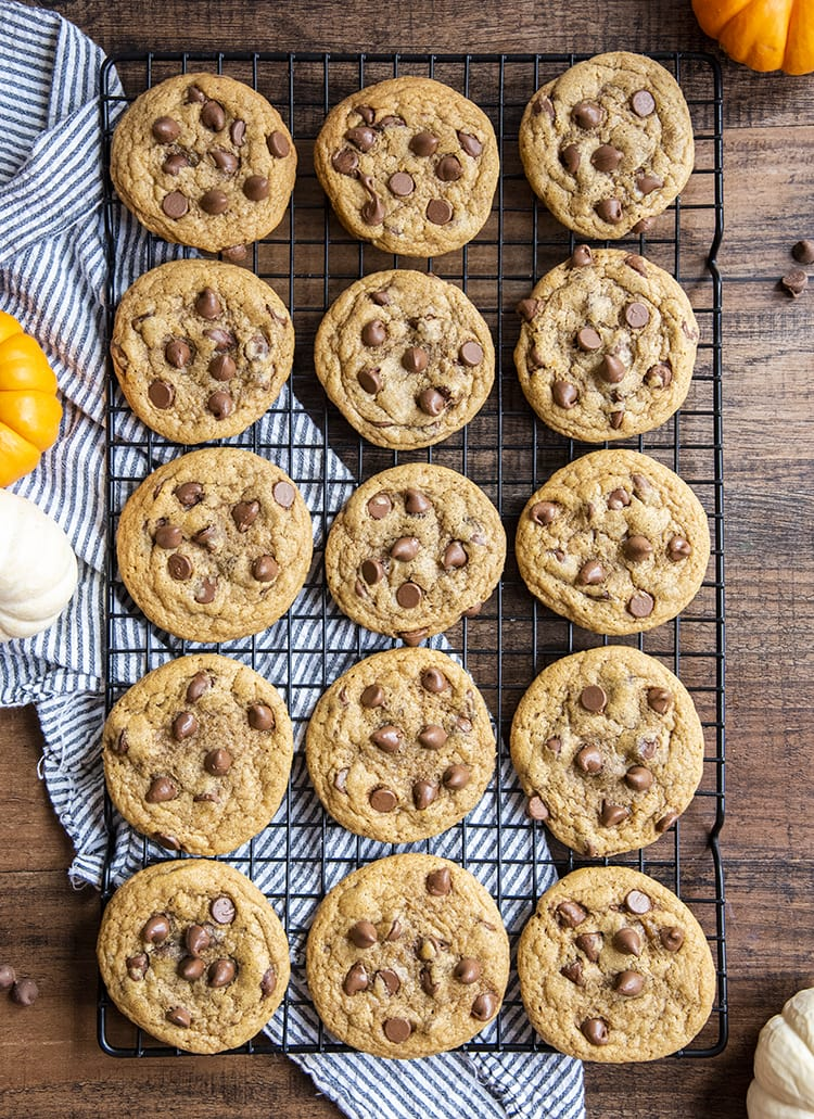 Chewy Pumpkin Chocolate Chip Cookies on a cooling rack.