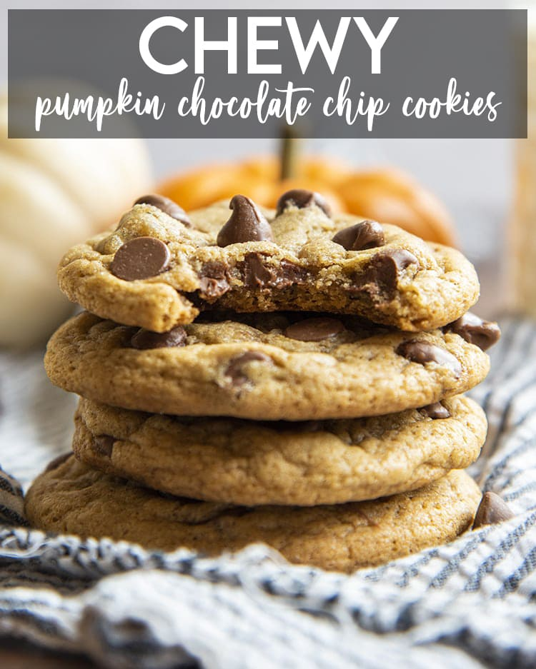 A stack of chewy pumpkin chocolate chip cookies. The top cookie has a bite taken out of it. There is a text overlay for pinterest.