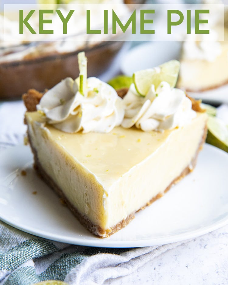 A slice of key lime pie on a white plate, topped with whipped cream dollops and thin half slices of key limes with a text overlay for pinterest.