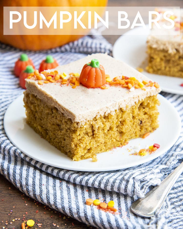 A pumpkin bar with cinnamon cream cheese frosting on a white plate with a text overlay for pinterest.