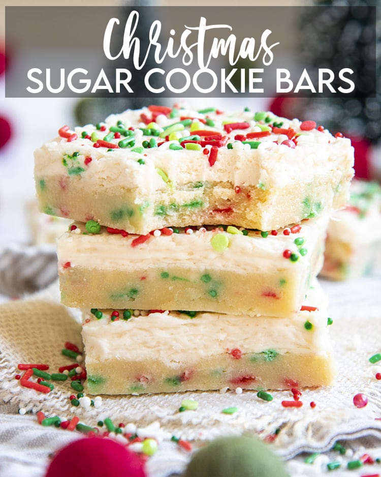 A stack of sugar cookie bars filled with red and green jimmie sprinkles, and topped with a white frosting, and more sprinkles, with a text overlay for pinterest.