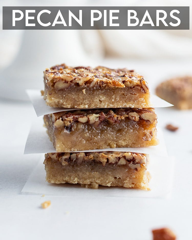 A stack of pecan pie bars with parchment paper between each one with a text overlay saying Pecan Pie Bars
