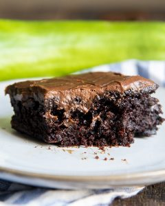 A close up of a chocolate zucchini brownie, with icing.