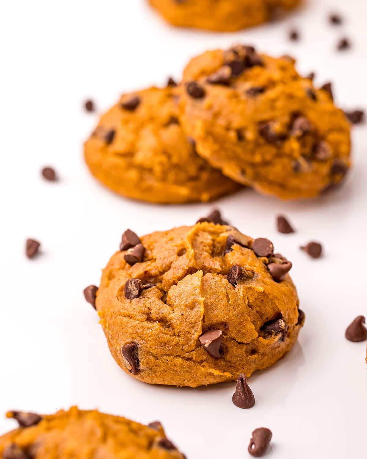 Pumpkin cake mix cookies on a white background.