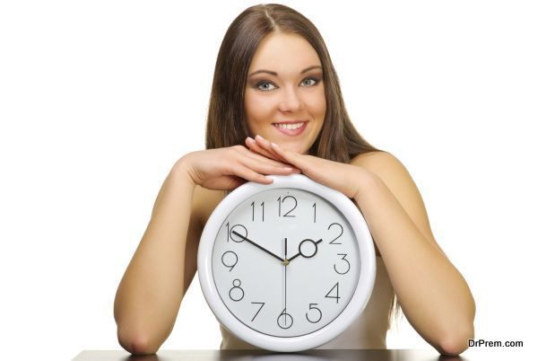Young girl with clock isolated