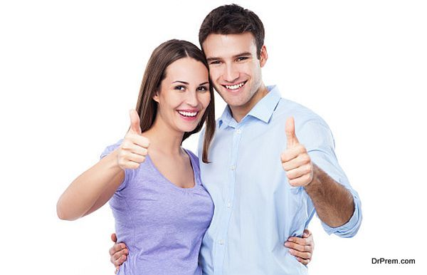 Young couple with thumbs up