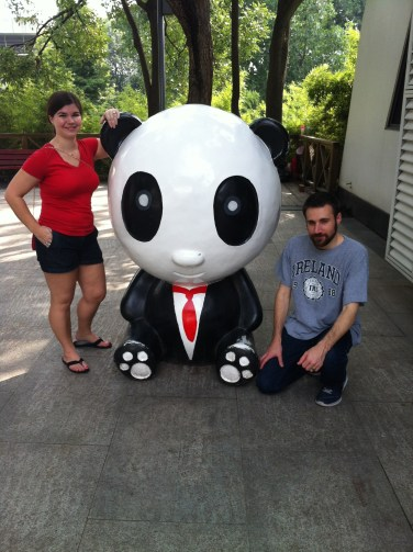 My husband, making friends with a more civilized panda.