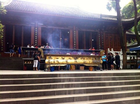 Incense censers in the temple adjacent to the buddha's head.