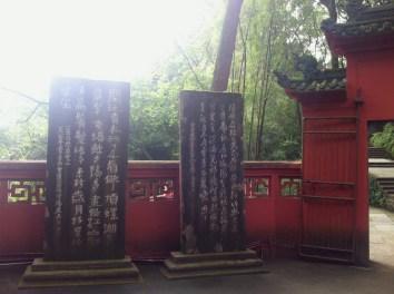 Poetic tablets near the buddha.