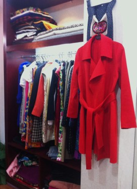 Someone's ruby-red winter coat, come to life between the tailor's hands.