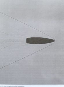 Shadowgraph photo of a bullet at Mach 2.06.