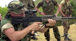 Royal Netherlands Marine Corps Capt. Charles Suilen (kneeling prone position), attached to the U.S. Marine Corps 4th Marine Expeditionary Brigade, Camp Lejuene, N.C., fires an SA-80 (Small Arms for the 1980s) assault rifle down range at Sierra Prieta, Dominican Republic, on April 20, 2004, during unilateral training at the Joint Task Force Tradewinds 04 Multinational Training Exercise. (U.S. Army photo by Kaye Richey) (Released)